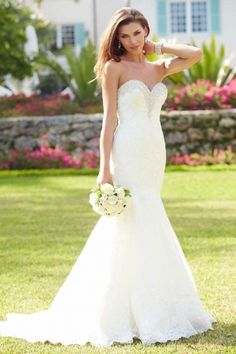 Allure Bridals - Rachelle. This gorgeous mermaid shaped gown has a fitted bodice with a sweetheart neckline embellished with Swarovski crystals. The entire design is adorned with delicate lace applique on English net.