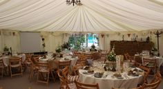 Vintage/Rustic look to a fully draped marquee, provided by Elite Marquees.