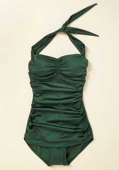It's ModCloth's ultimate swimsuit - now in a rich emerald hue! The holy grail of swimwear, this swimsuit by the iconic Esther Williams features low-cut legs, flattering side ruching, and a retro fit that wows on many body types. Flaunt your flair for vintage fashion by making a splash in this bold look!