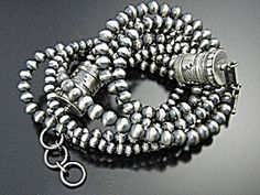 Sterling Silver American Indian 3 Strand necklace by Doreen Leyba. The Necklace is 18 Inches and 3 Stands with Barrel Beads at each end and a Toggle Clasp. 54 Grams.