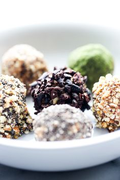 Bliss Balls all up in your face. Made with healthy raw ingredients to the likes of; almonds, matcha powder, and coconut to name a few. Get your bliss on!
