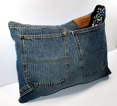 Upcycle Recycled Designer Denim Jeans TV Remote Control Storage Pocket Pillow. I have soo many old jeans I need to get rid of.. I'm using this idea & will put the rest with a quilt.  Thank you pinterst!