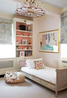 sweet girl's bedroom with Nina Campbell Swan lake shades, a low Scandinavian wood bed, and a red metal chandelier // children's rooms
