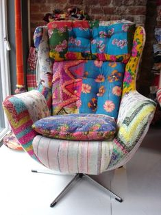Love the idea of reupholstering a chair in different brightly colored fabrics.