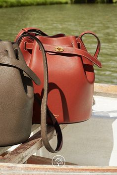 The Abbey is a traditional 'bucket bag' with drawstring detailing, contrast lining and a range of eye-catching or iconic leather finishes. The Abbey features the iconic postman's lock as a nod to Mulberry's heritage DNA, securing a simple belt closure on a timeless, easy to wear style.