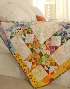 Dotty Stars | AllPeopleQuilt.com - Gather up all the polka dot prints you can find to combine in a bright and youthful-looking throw.