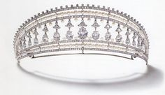 "When Cartier took up making the 'kokoshnik' (""cock's comb) style of tiara around 1900 they  fashioned them with diamond drops suspended from a gallery within an openwork mount. Our example is a Kokoshnik made by Cartier Paris 1908, Set in platinum with fifteen pear-shaped diamonds round old cut diamonds, pearls, and a stunning lily of the valley setting for the swinging pear-shaped diamonds. Many of the styles they made are quite simply chic and very beautiful."