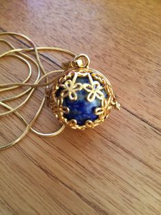 crystal locket (gold plated) with lapis lazuli by wellbeingbliss on Etsy