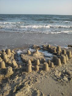 The simplicity of these #sandcastles speaks to my heart.  #sandcastle #udderlysmooth