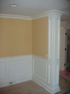 Picture frame molding with molded column. Good between dining room and kitchen.
