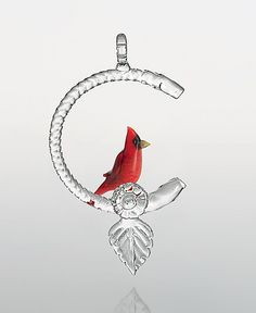 """""""Cardinal"""" #art glass #ornament by Chris Pantos. Perched on an elegant arc of clear lampworked glass, this cheerful cardinal brightens your surroundings with his vermilion plumage."""