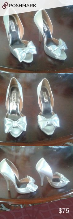 A nice pair of Badgley Mischka  silver shoes. I bought these shoes for $189.00. They are too small for me. They are 71/2 Medium but I think they fit more like a size 61/2 or 7. I am so sad they do not fit me cause I am 71/2 or 8 I am putting it on sale for $75.00 so a Diva like me can enjoy them. Box is included. Feel free to make an offer.  I am open to trade for something very nice. . By the way the shoes are tried on but never worn. Badgley Mischka Shoes Heels