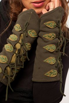 Polyester fleece wrist warmers with appliqued leaves. Goa Trance, Steampunk, Psytrance, Hippie,Boho,Tribal festival clothing. Pocket belts, hats and wrist Warmers.Visit our shops in Camden and Greenwich Markets http://gekko-london.com/style-gallery/25/77/618