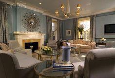 eliware:  living room  blue walls, silver drapes, venetian chandelier, silver sunburst mirror, ...