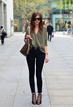 A draped, crossover blouse is simple and chic. Pair it with your go-to black skinnies and lace up heels for a great going out look for fall.