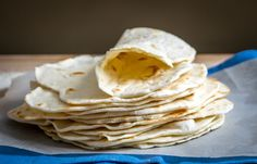 These light, delicious homemade flour tortillas have only four ingredients and come in at just under eight cents each. So good!