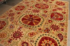 Love to get a Suzani rug.....