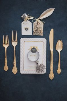 Gold flatware on a navy background | Bellamint Photography |