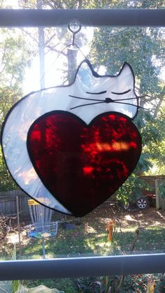 Whispy White Cat on a heart Stained glass by AnnersGlassShack