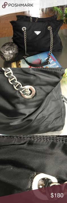 VIntage Prada Nylon Shoulder Bag GUC/Some fraying on the back grommets probably can be repaired by shoe maker by tucking under grommet / super clean interior/3 sections . Clean with no odors. Nylon a bit wrinkled.This is a vintage item. Some wear on the chains . Leather good. Price reflects this. Absolutely no fraying of the Nylon near the front grommets of the purse. Please observe pics! Prada Bags Shoulder Bags