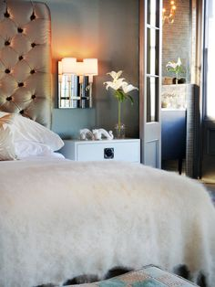 Light It Up: 12 Illuminating Ideas for the Bedroom : Rooms : Home & Garden Television  While this may be a little too much glamour for my hubby...this bedroom has some serious sparkle. I like the headboard (color and design) juxtaposed with that blue on the wall and I just love all the white. Gorgeous.