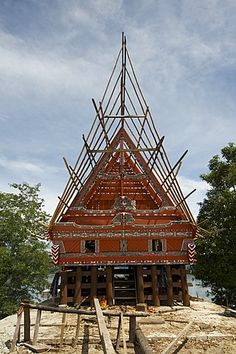 Construction of traditional style Batak house with bamboo scaffolding, beside the volcanic Lake Toba, Samosir Island, Sumatra, Indonesia, Southeast Asia, Asia