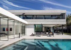 Pitsou Kedem's S House balances concrete box above glazing
