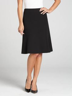 Perfect for work, this black mid-length crepe skirt is versatile and a great transitional piece. Wear it as is in the Fall and with tights in the Winter. Back zip with hook