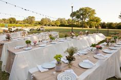 Long tables, champagne colored runners, and a variety of mix-matched centerpieces with pretty wildflowers. PERFECT!