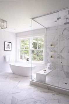 Amazing Bathrooms with Stunning Details white bathroom design with white vanity and white marble quartz counter and bathroom mirror with bathroom sconce and tile floor and subway tile shower Modern Master Bathroom, Modern Bathroom Design, Bathroom Interior Design, Master Bathroom Tub, Bling Bathroom, White Master Bathroom, Vanity Bathroom, Modern Bathrooms, Minimalist Bathroom