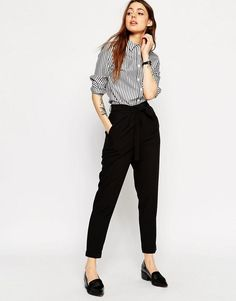 Black women's work wear pants with pockets and a striped collar shirt. Women's peg trousers for work.