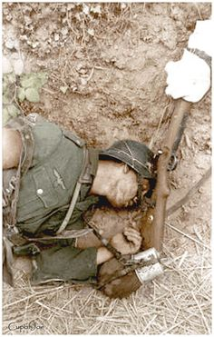 A Bundesarchiv photograph of a dead German soldier who fell in Normandy soon after D-Day. Note the bullet hole puncturing the front right temple of his helmet. (June by Tburg* Nagasaki, Hiroshima, D Day Photos, Ww2 Photos, Ww2 Pictures, Colorized Photos, Photographs, German Soldiers Ww2, German Army