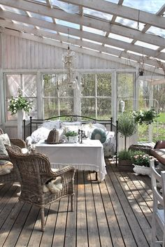 Outdoor - Beautiful white greenhouses with lush green plants, leaves and leafy florals | Dream garden | Gardening inspiration | By jewellery label AU REVOIR LES FILLES | Shop at www.aurevoirlesfilles.com