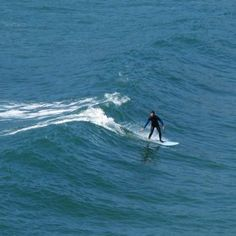 Surfing in Longchamp, Brittany