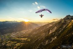 High up in the air, the Alps, a sunset and a full stall glider w
