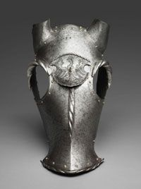 Chanfron (headpiece for a horse), c 1515-1520, Etched and partially blackened steel; brass; leather (replaced)  Approximately: 16 1/8 x 12 3/16 x 20 7/8 inches (41 x 31 x 53 cm) Weight: 7.3 lb. (3297g)