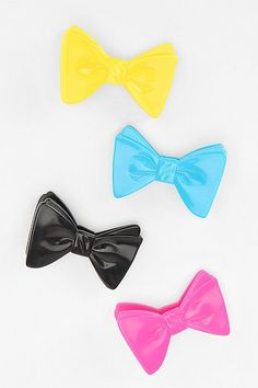 Bow Bag Clips - ok, so $12 plus tax & shipping is so not worth it for four plastic clips, and I don't even eat chips often, but... so cute! Actually, one of these on a gift package of baked goods would be delovely!