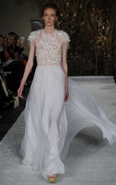 Mira Zwillinger gown with floral appliques and high neckline | Mira Zwillinger Spring 2017 | https://www.theknot.com/content/mira-zwillinger-wedding-dresses-bridal-fashion-week-spring-2017