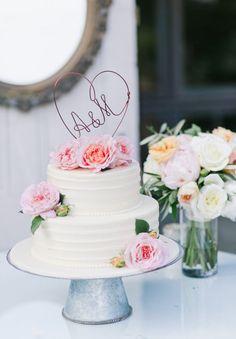 Gorgeous peony adorned cake: http://www.stylemepretty.com/california-weddings/aptos/2015/08/31/rustic-elegant-outdoor-wedding-at-devine-ranch/ | Photography: Bluella - http://bluella.com/