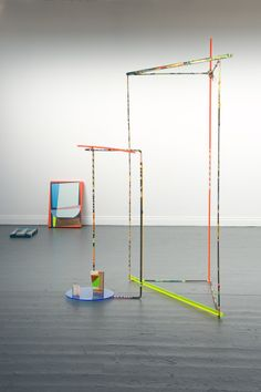 Abstract assemblage - Perspex rods and circle,steel, painted tape, wooden block painting and plastic string