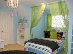 Love this for Evie's room....cool idea for partitioning off with curtains!