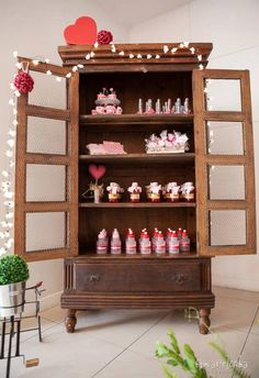 Love this display at A Heart Party with Lots of Really Cute Ideas via Kara's Party Ideas KarasPartyIdeas.com #ValentinesDay #HeartParty #LoveParty #PartyIdeas #PartySupplies