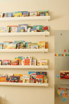 magnet board and rain gutter bookshelf. Gutter Bookshelf, Bookshelves, Boy Room, Kids Room, Magnetic Wall, Magnetic Boards, Montessori Playroom, Space Toys, Kid Spaces