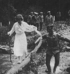 "An officer helping the Grand Duchess Anastasia Nikolaevna Romanova of Russia across a log. ""AL"""