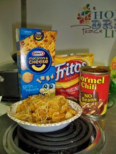 What you need:  1 box of Kraft Mac N Cheese  1 bag of Fritos  1 jar of Hormel No Beans Chili  1 bag of Shredded cheese    Cook Macaroni according to directions on box and then warm up chili. Take chili out and stir it into the mac n cheese. After stirring in chili, sprinkle with shredded cheese, then serve!  When serving, place a layer of Fritos on the bottom of the bowl/plate and then serve the chili cheese macaroni!