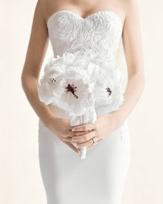 "An Everlasting Bouquet--For her bouquet, ""I knew I wanted peonies, but there aren't any in January,"" says JoJo. The solution: Scott fashioned the fluffy flowers from feathers and bound them with velvet ribbon."