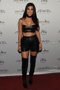 Kourtney Kardashian wearing Aquazzura Velvet Over the Knee Boots, August Getty Atelier Fall 2015 Leather Bandeau and Proenza Schouler Leather Shorts