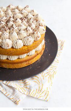 Pumpkin Tiramisu Cake - pumpkin spice cake soaked with coffee liqueur, fluffy mascarpone frosting and chocolate shavings | Tessa Huff for TheCakeBlog.com