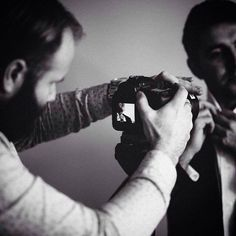 Photographer @craiggeorge captured this great image of zen film works cinematographer @chris.nemes Shooting the #groom preparation at a NYE wedding we both worked on at a #chateau in #france . #film #wedding #photography #zenfilmworks #francewedding #blackandwhite #canon #tiltshift #cinematography