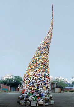 Tornado of plastic waste. 'Thrown to the Wind' - a 36 feet trash tower installation by Wang Zhiyuan. Beijing, China.